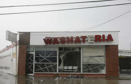 A washateria is seen with destruction caused from the winds of Hurricane Ike. Photo: Julio Cortez, Chronicle