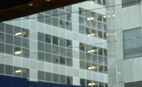 Strong wind from Hurricane Ike shattered glass at a building across from the JPMorgan Chase Tower in downtown Houston. Photo: Chronicle