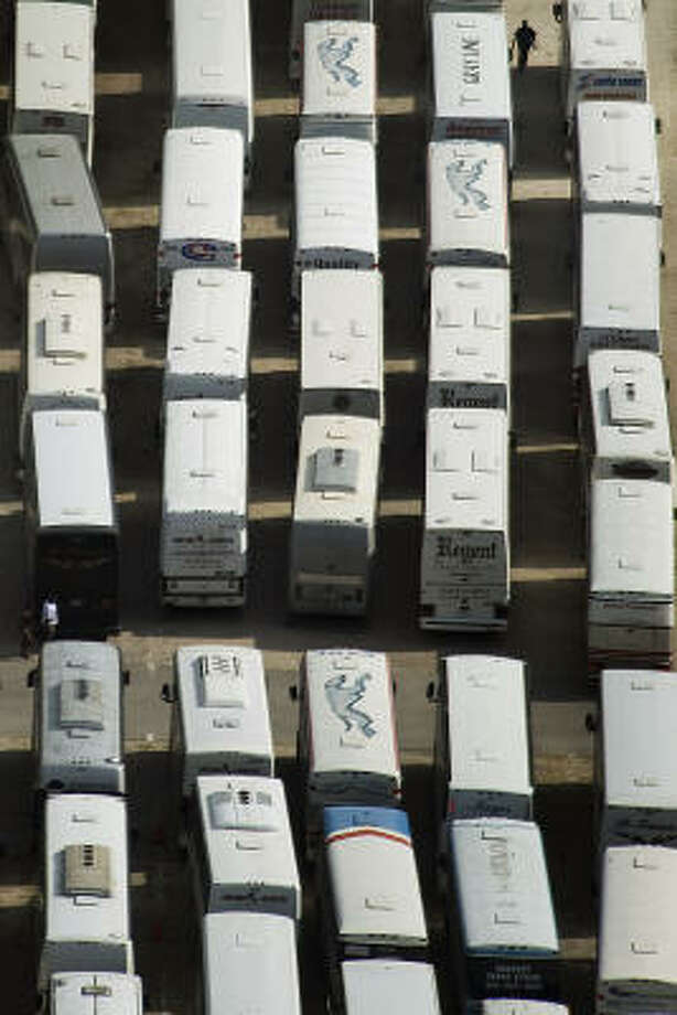 Lines of buses are staged at Tully Stadium,  Thursday, Sept. 11, 2008, in Houston. Photo: Smiley N. Pool, Chronicle
