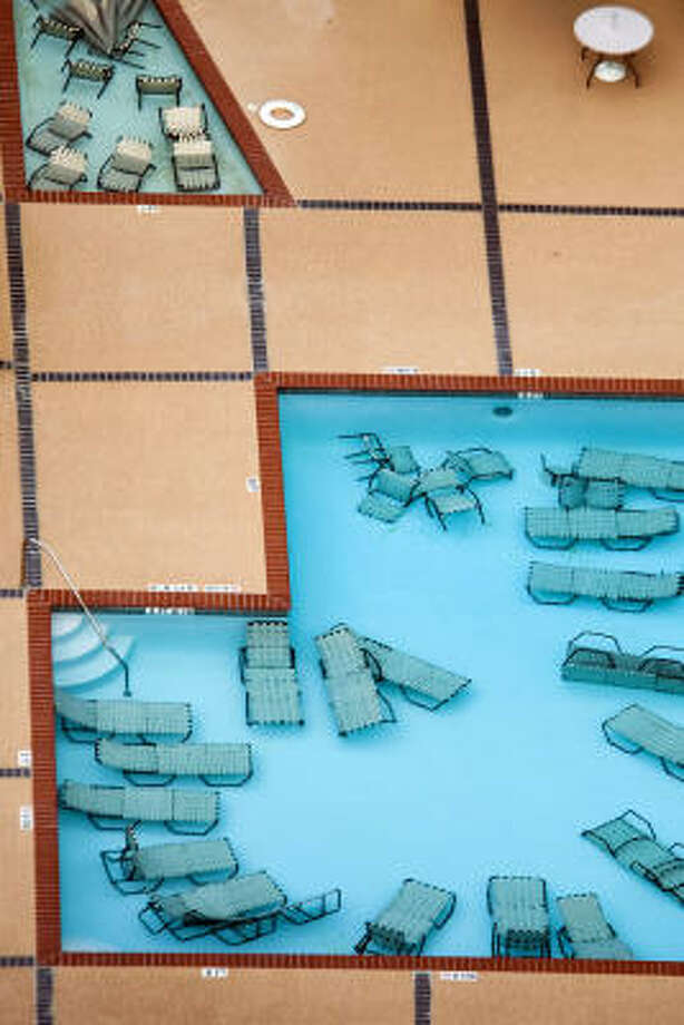 Patio furniture is submerged in the swimming pool of a west side apartment complex, Thursday, Sept. 11, 2008, in Houston. Photo: Smiley N. Pool, Chronicle