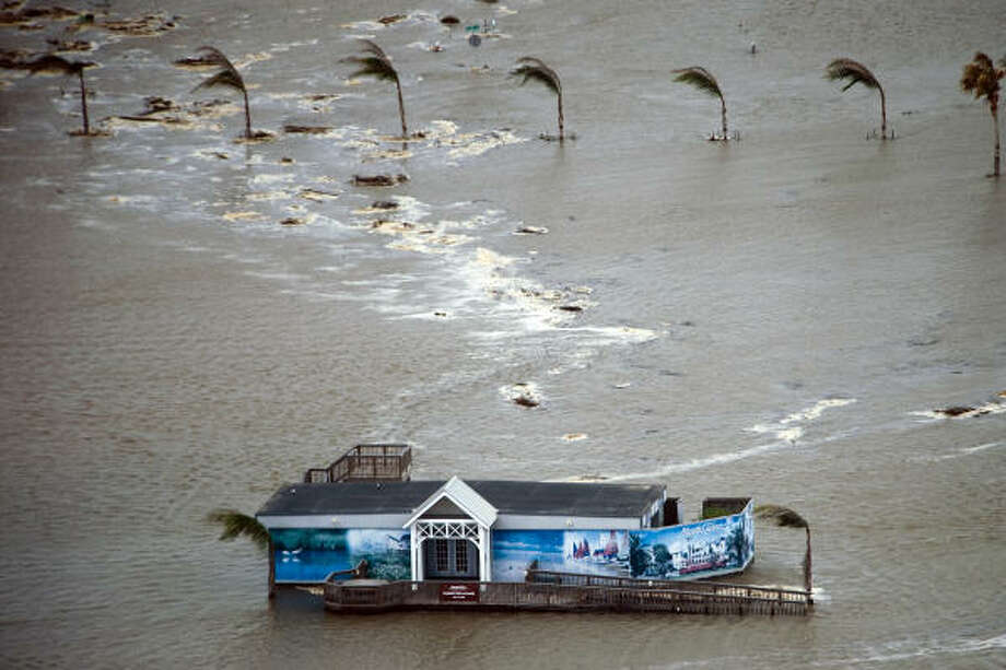 Floodwaters surround a real estate office on Galveston Island, Friday, Sept. 12, 2008. Photo: Smiley N. Pool, Houston Chronicle