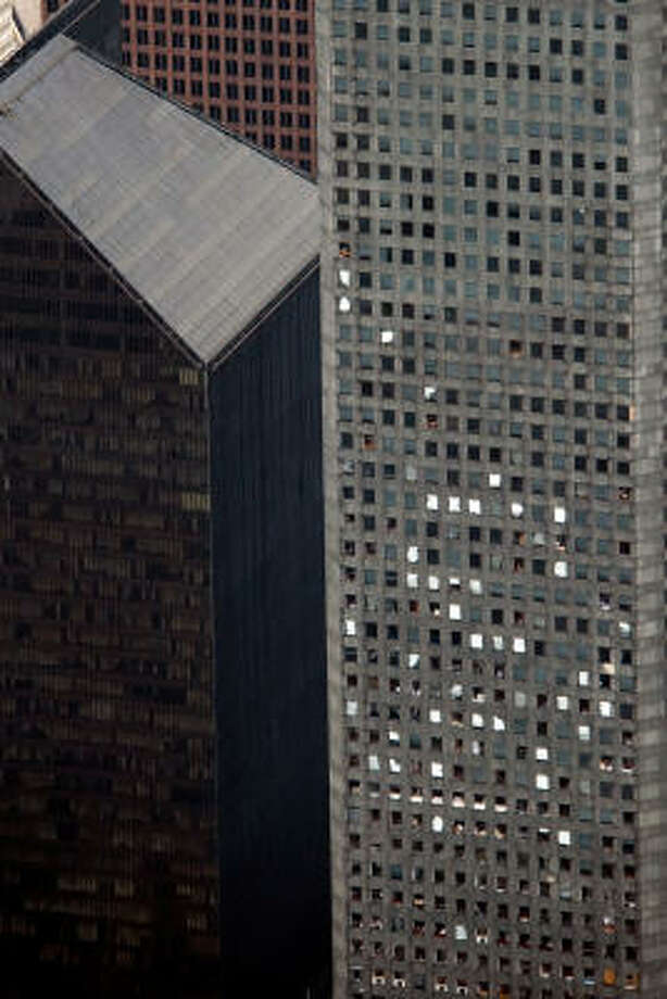 Damaged windows are seen on the Chase building after the passing of Hurricane Ike, Saturday, Sept. 13, 2008, in Houston. Photo: Smiley N. Pool, Chronicle
