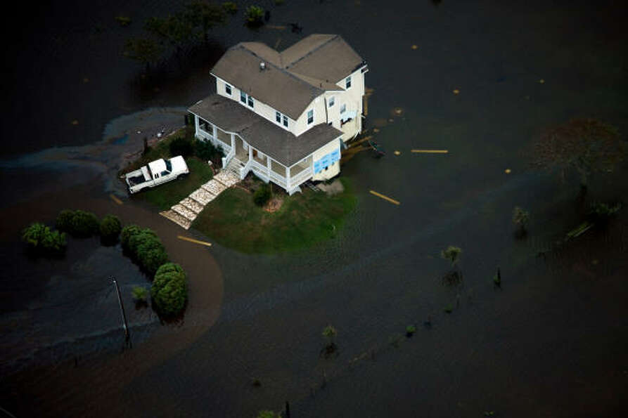A house is seen surrounded by floodwater on Galveston Island after the passing of Hurricane Ike, Sat