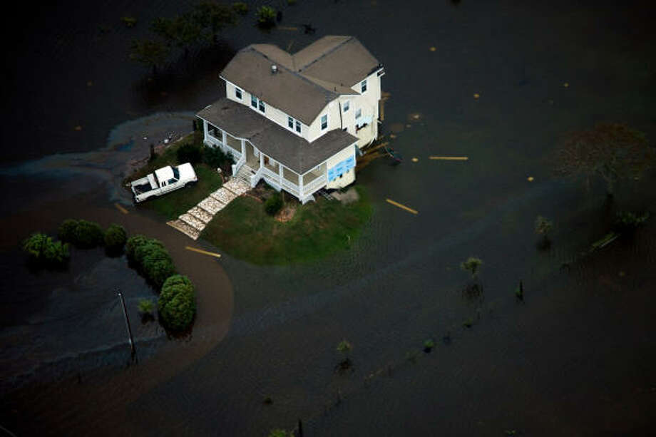 A house is seen surrounded by floodwater on Galveston Island after the passing of Hurricane Ike, Saturday, Sept. 13, 2008. Photo: Smiley N. Pool, Chronicle