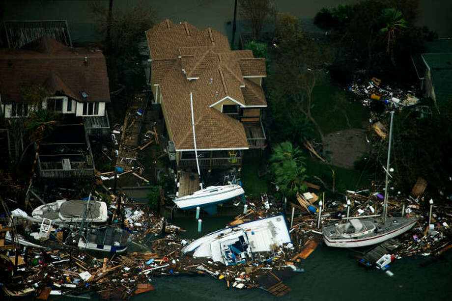 Boats and debris are seen surrounding waterfront houses on Galveston Island after the passing of Hurricane Ike, Saturday, Sept. 13, 2008. Photo: Smiley N. Pool, Chronicle