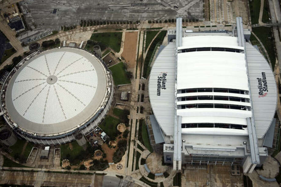 Damage to the retractable roof of Reliant Stadium is seen after the passing of Hurricane Ike, Saturday, Sept. 13, 2008, in Houston.   The Reliant Astrodome is at left. Photo: Smiley N. Pool, Chronicle