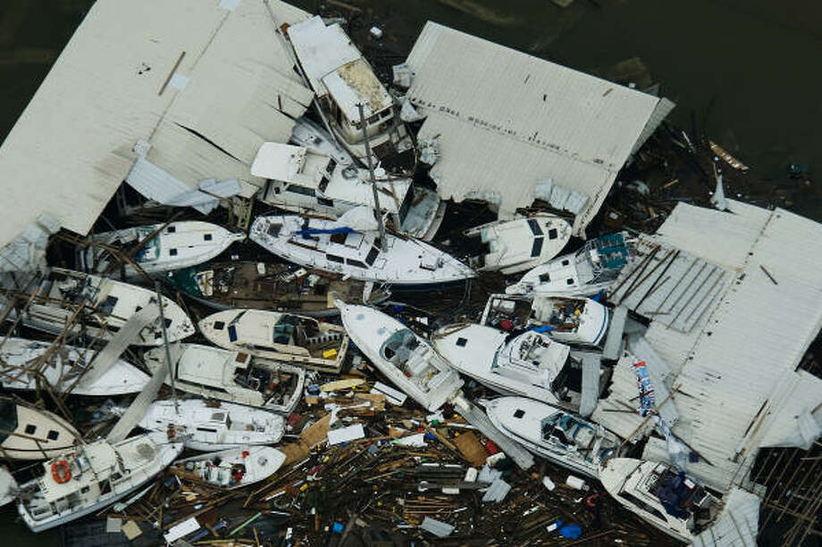 Damaged boats are seen at a marina on Galveston Island after the passing of Hurricane Ike, Saturday, Sept. 13, 2008. Photo: Smiley N. Pool, Chronicle