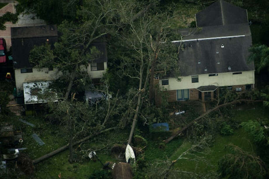 Fallen trees are seen against houses after the passing of Hurricane Ike, Saturday, Sept. 13, 2008, in Seabrook. Photo: Smiley N. Pool, Chronicle
