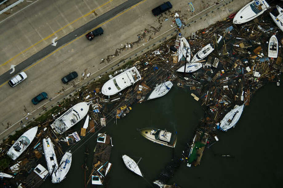 Boats and debris are seen against a bridge after the passing of Hurricane Ike, Saturday, Sept. 13, 2008, in Clear Lake City. Photo: Smiley N. Pool, Chronicle