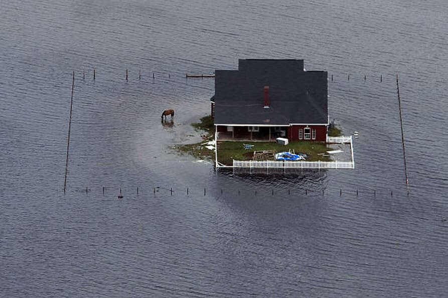 Floodwaters surround a house near Winnie after  Hurricane Ike, Sunday, Sept. 14, 2008.
