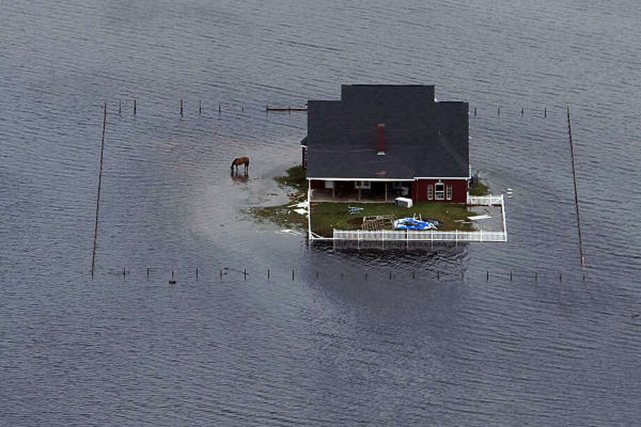 Floodwaters surround a house near Winnie after  Hurricane Ike, Sunday, Sept. 14, 2008. Photo: Smiley N. Pool, Chronicle