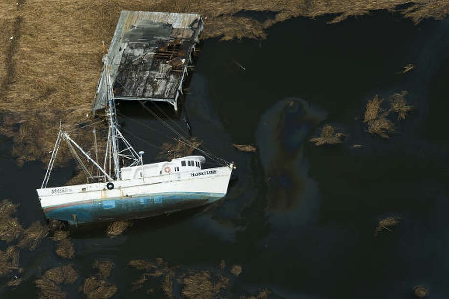 A boat is seen overturned along Texas Highway 73 near Winnie, Texas, Sunday, Sept. 14, 2008. Photo: Smiley N. Pool, Chronicle