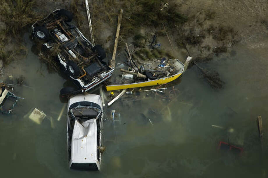 Overturned automobiles and boats are seen amidst debris left by Hurricane Ike, Sunday, Sept. 14, 2008, in Gilchrest. Photo: Smiley N. Pool, Chronicle