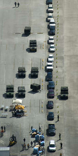 A long line forms for water and food at a FEMA distribution center after Hurricane Ike, Monday, Sept