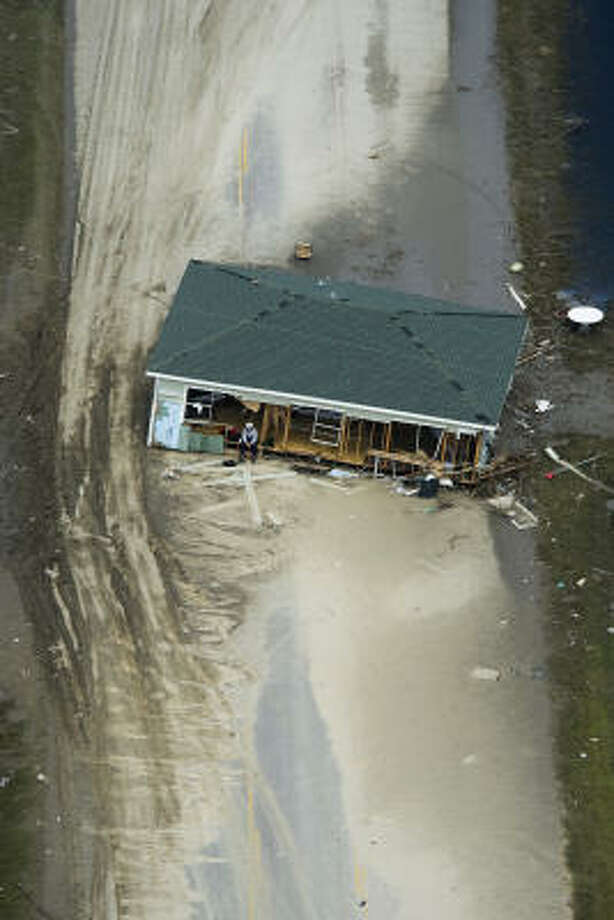 A search worker rests in a house which lies across Highway 87 near Crystal Beach, Monday, Sept. 15, 2008. Photo: Smiley N. Pool, Chronicle