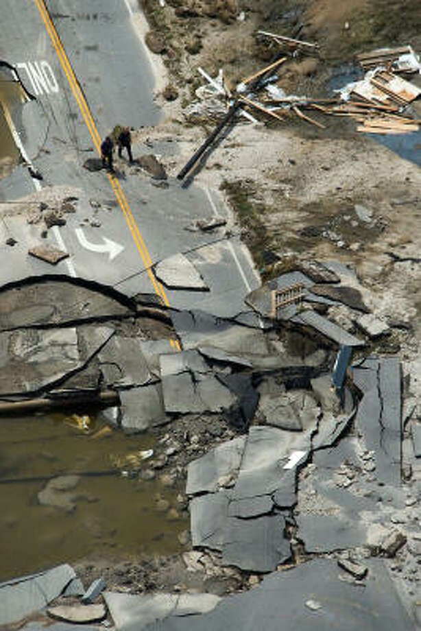 Workers walk through rubble that is left of Highway 87 on the Bolivar Penninsula after Hurricane Ike, Monday, Sept. 15, 2008. Photo: Smiley N. Pool, Chronicle
