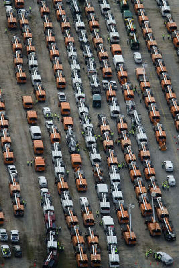 Hundreds of utility trucks are seen staged in a parking lot in response to Hurricane Ike, Monday, Sept. 15, 2008, in Houston. Photo: Smiley N. Pool, Chronicle