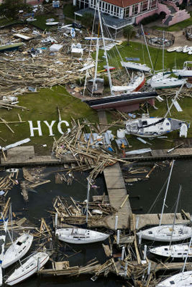 Sailboats and debris can be seen strewn about the Houston Yacht Cub after Hurricane Ike, Tuesday, Sept. 16, 2008, in Shoreacres. Photo: Smiley N. Pool, Chronicle