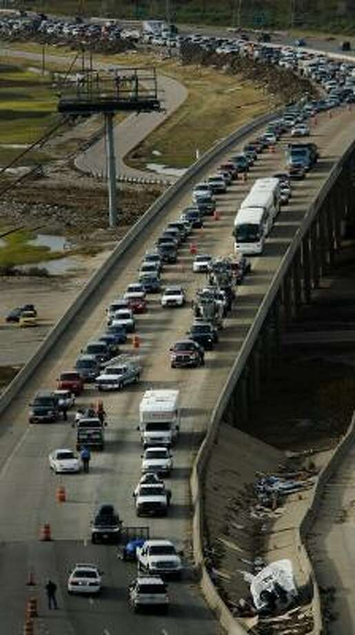 Traffic backs up on Interstate 45 southbound just before the Galveston Causeway as residents are allowed back on the island for the first time following Hurricane Ike, Tuesday, Sept. 16, 2008. Photo: Smiley N. Pool, Houston Chronicle