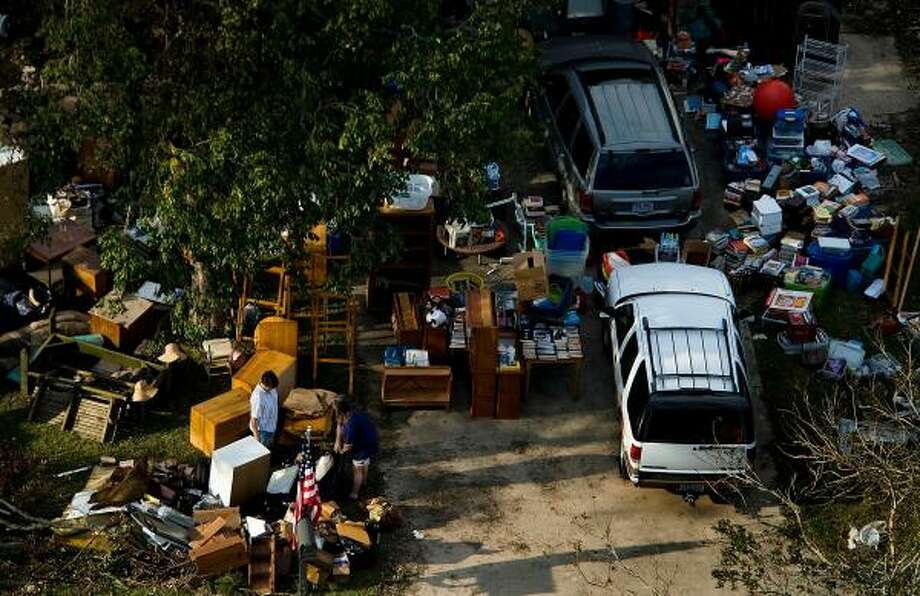 The contents of a home  are seen spread out in the lawn of a house in LaPorte as residents begin cleaning up after Hurricane Ike, Tuesday, Sept. 16, 2008. Photo: Smiley N. Pool, Chronicle