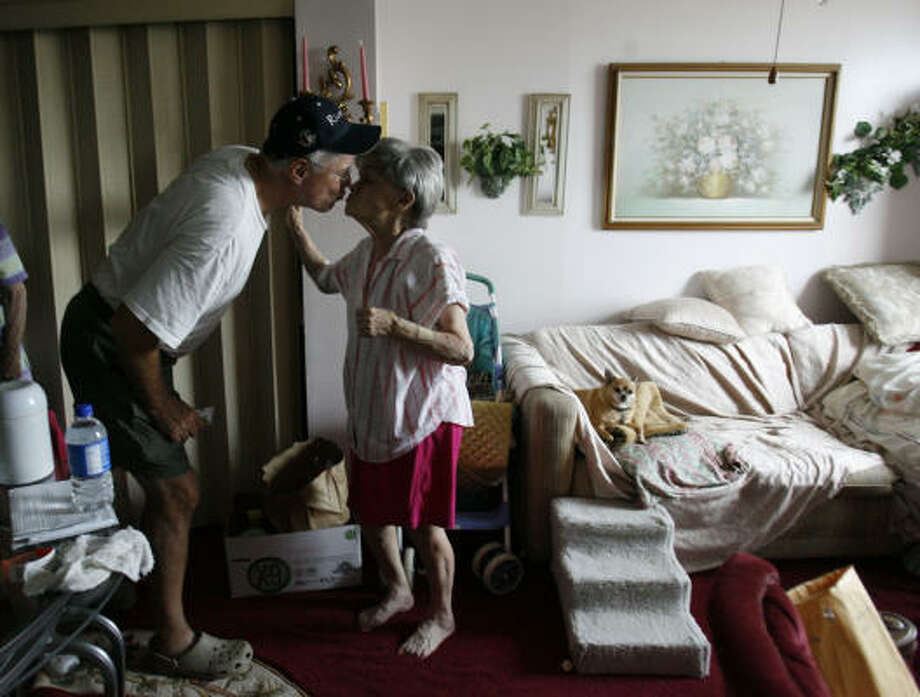 Ralph Hayes kisses Bobbie Davis, 79, who has been living at the Heights House at 20th and Heights for several years. Davis stayed through the hurricane, but she and several residents were without power and food, and Hayes helped out Sept. 14 by bringing them sandwiches and water. Photo: Karen Warren, Chronicle