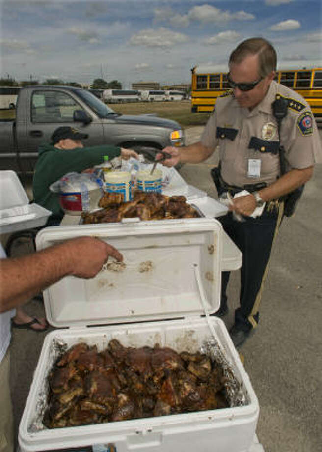 Spring Branch ISD Chief Chuck Brawner is among those served chicken at Tully Stadium. Buses were staged and fueled in the stadium's parking lot and stood ready to transport evacuees as needed in the aftermath of Hurricane Ike. Photo: Steve Ueckert, Chronicle