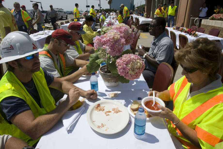 A crew with Georga Power in Valdosta, Ga., Kevin Davis, left, and Vicky Biles, right, along with other utility crews and first responders were welcomed at Gaidos Restaurant along Seawall Boulevard on Sept. 18. Photo: Johnny Hanson, Chronicle