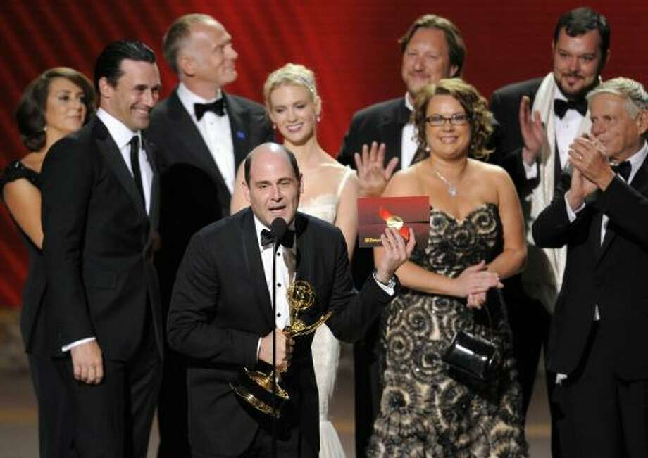 Producer Matthew Weiner, along with cast and crew, accept the award for the outstanding drama series for Mad Men at the 60th Primetime Emmy Awards. Photo: Mark J. Terrill, Associated Press