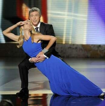 Co-hosts Heidi Klum and Tom Bergeron perform in a skit. Photo: Mark J. Terrill, Associated Press