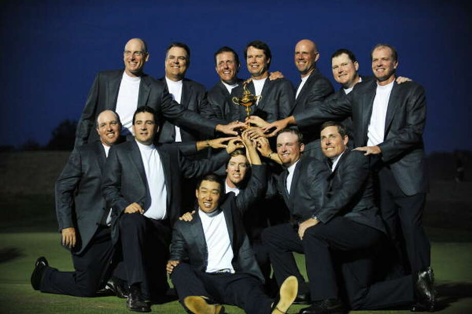 Team USA (top row L-R) Jim Furyk, Kenny Perry, Phil Mickelson, Captain Paul Azinger, Stewart Cink, Chad Campbell, Steve Stricker, (kneeling L-R) Boo Weekley, Ben Curtis, Anthony Kim, Hunter Mahan, J.B.Holmes and Justin Leonard pose with the Ryder Cup trophy at the end of the 37th Ryder Cup Sunday at the Valhalla Golf Club in Louisville, Ky. Photo: TIM SLOAN, AFP/Getty Images