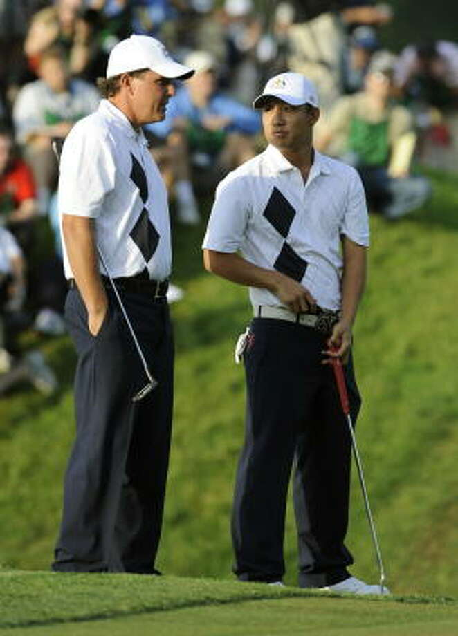 Phil Mickelson and Anthony Kim confer. They led off play for the U.S. team on Friday during foursomes play at the Ryder Cup at Valhalla Golf Club in Louisville, Ky. Photo: TIMOTHY A. CLARY, AFP/Getty Images