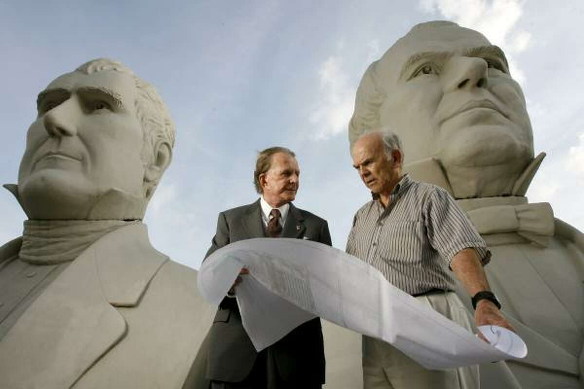 Developer Richard Browne, left, and artist David Adickes chat in front of Adickes' presidential busts. Browne is planning a presidential park and mixed-use development near Pearland that would display Adickes' busts.