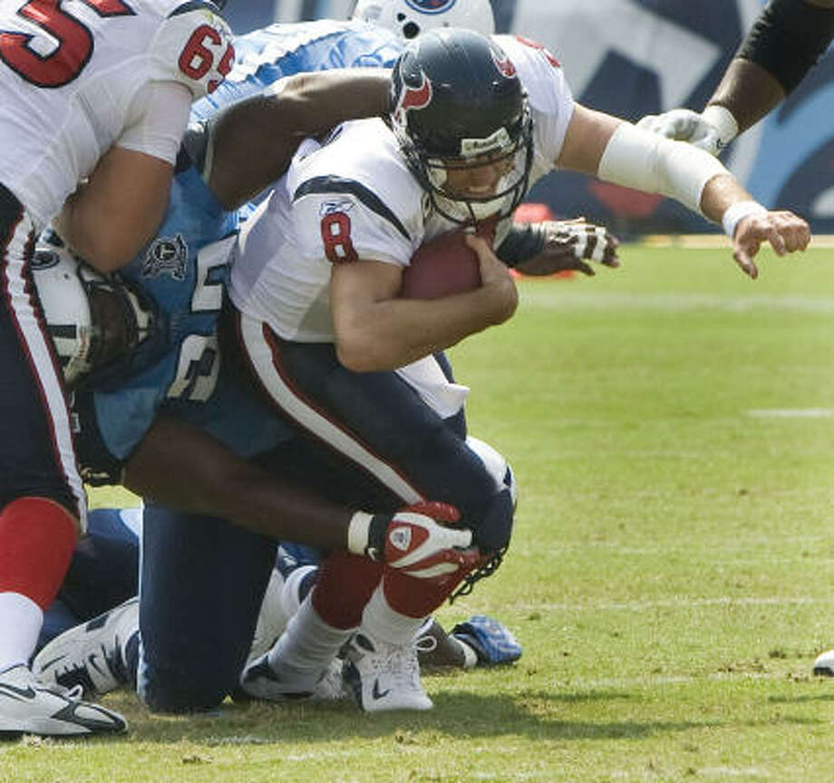 Texans quarterback Matt Schaub was roughed up early and often in Sunday's 31-12 loss to the Titans. He threw three interceptions, including one that was returned 99 yards for a touchdown, was sacked three times and finished with a quarterback rating of 27.8. Photo: Brett Coomer, Chronicle