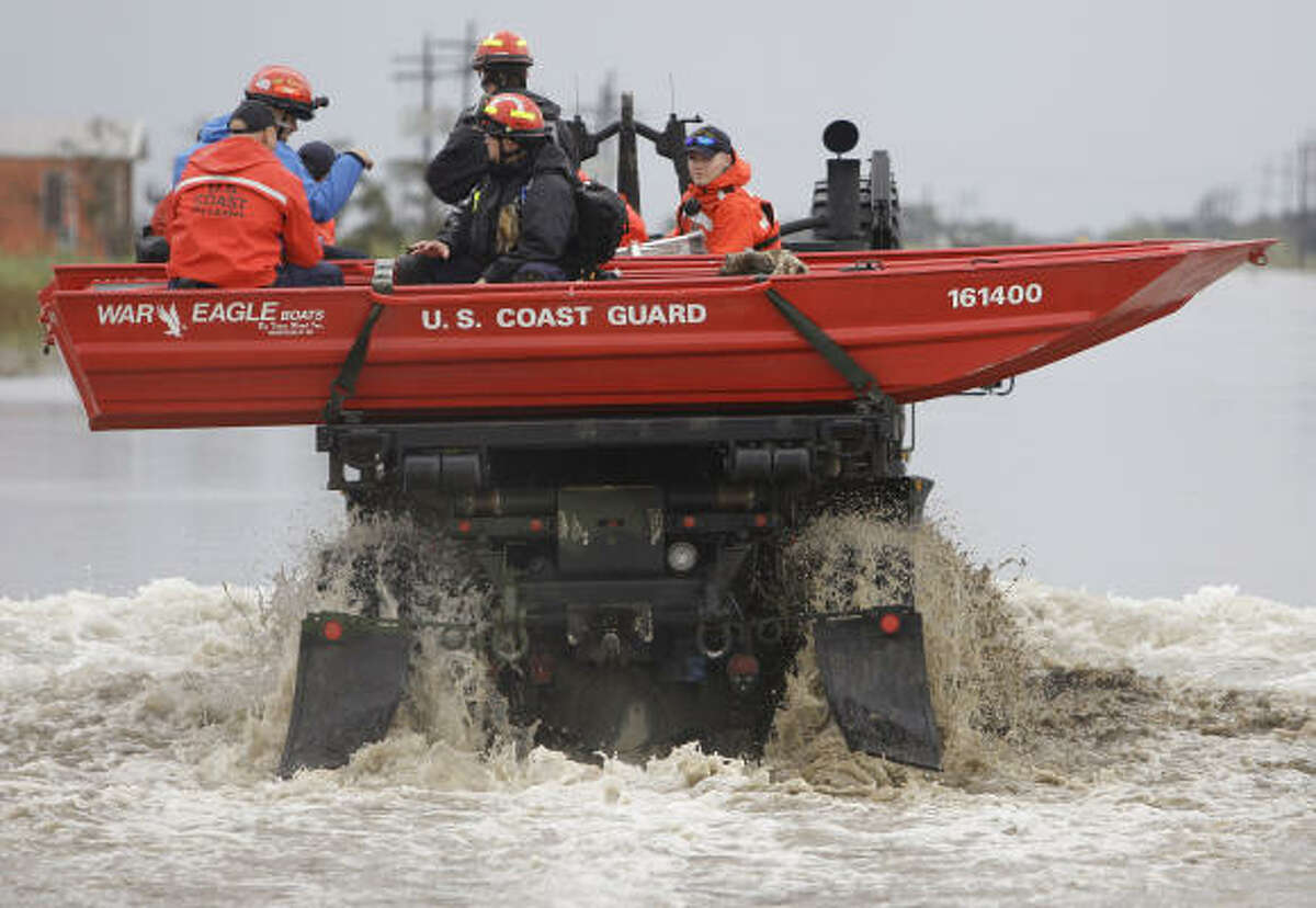 A Coast Guard search and rescue team heads into the flooded areas of Sabine Pass.