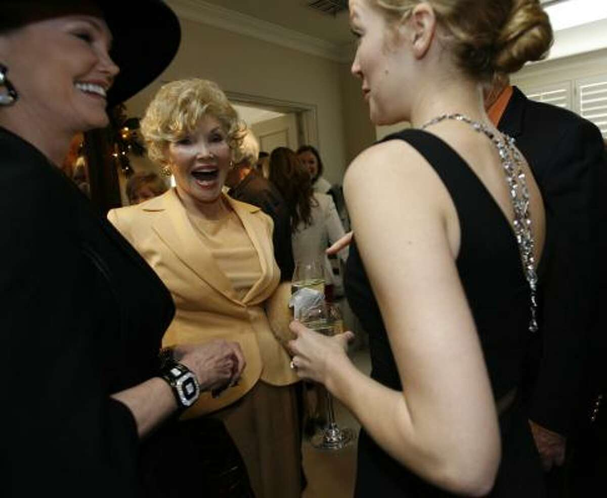 Joanne Herring, center, laughs with Kelly Day, left, and Mary Bonner Baker at the Kazanjian Foundation. The Kazanjians are jewelers, and they loaned their precious baubles to the Texans attending the premiere of Charlie Wilson's War in Los Angeles.
