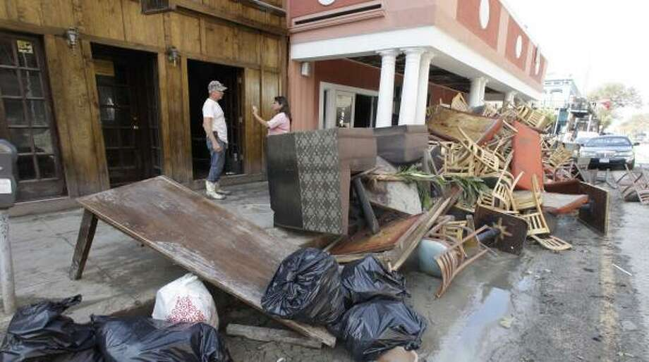 Trash from the cleanup from Hurricane Ike begins to collect in the street in Galveston's historic downtown district Sept. 20.>>Here are heartbreaking photos of the destruction and flooding caused by Harvey... Photo: Rick Bowmer, AP