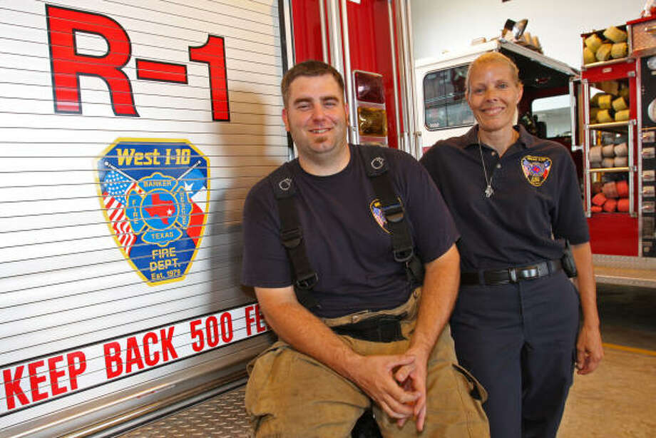 LENDING A HAND: West I-10 firefighters Jason Tharp, 26, and Pam Rizo, 48, were deployed for three days to the Seabrook fire station to relieve Seabrook firefighters in the aftermath of Hurricane Ike. Photo: Suzanne Rehak, For The Chronicle