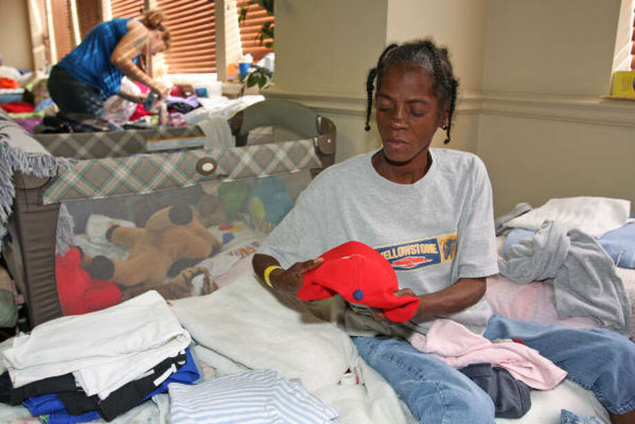 Shirley Goodman, Hurricane Ike evacuee from Houston, folds her clothes after waking up in the Red Cross Shelter at Grace Fellowship United Methodist Church. Photo: Suzanne Rehak, For The Chronicle