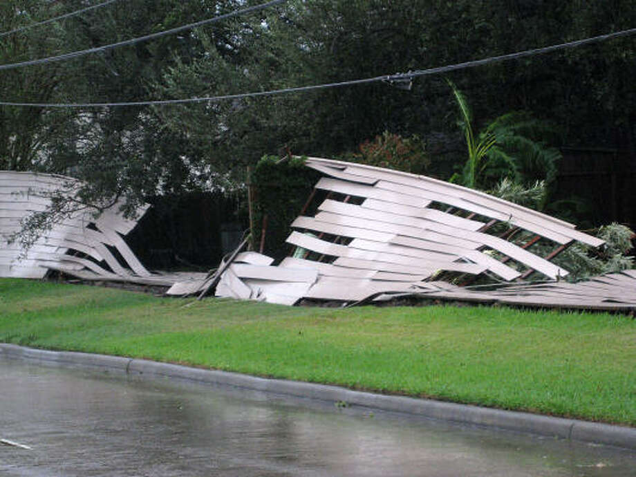 Blown down fences line the road at Westgreen and I-10 in Katy after Hurricane Ike blew through the city early Saturday morning. Photo: Diana L. Porter, For The Chronicle