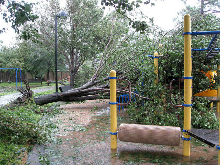 An uprooted tree lays on top of playground equipment in Katy in the Green Trails subdivision at Greenhouse and Chitwood after Hurricane Ike smashed through the city early Saturday morning. Photo: Diana L. Porter, For The Chronicle