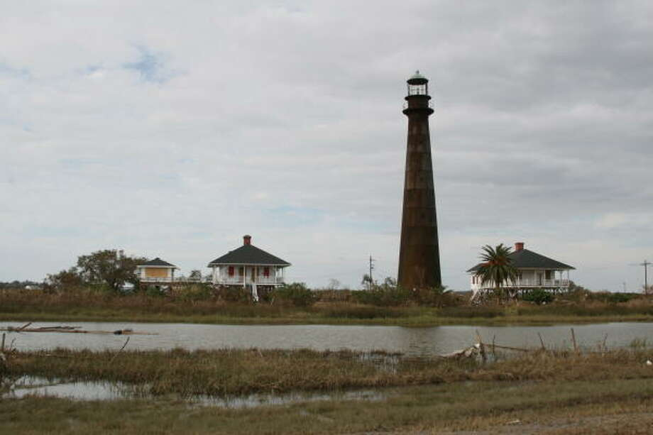 Still standing. The Bolivar Lighthouse, which survived the 1900 Storm, survived this latest assault. Photo: Shannon Tompkins, HOUSTON CHRONICLE