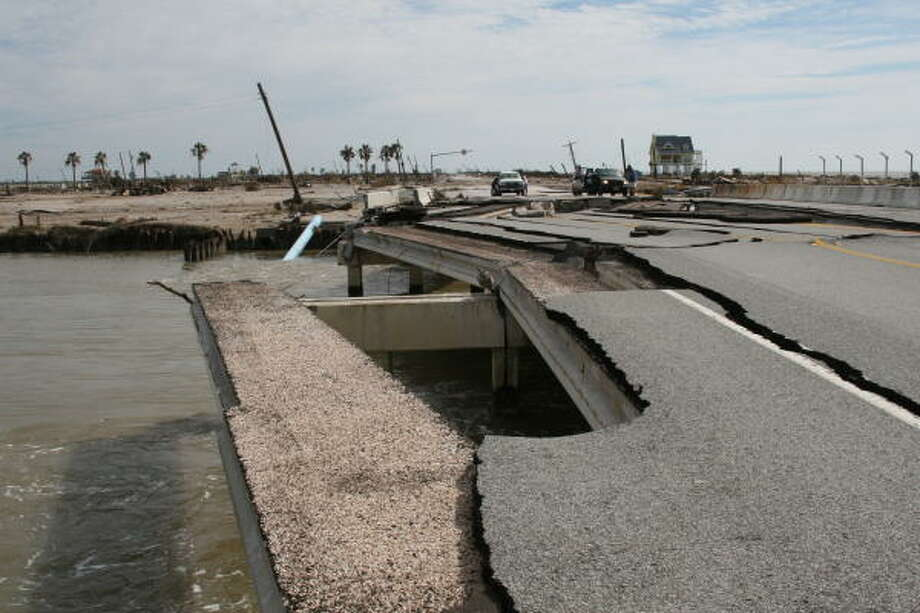 Storm surge from Hurricane Ike severely damaged the State Highway 87 bridge spanning Rollover Pass near Gilchrist on Bolivar Peninsula. Only one lane of the four-lane bridge remains intact, and that single lane is unsafe. Photo: Shannon Tompkins, HOUSTON CHRONICLE