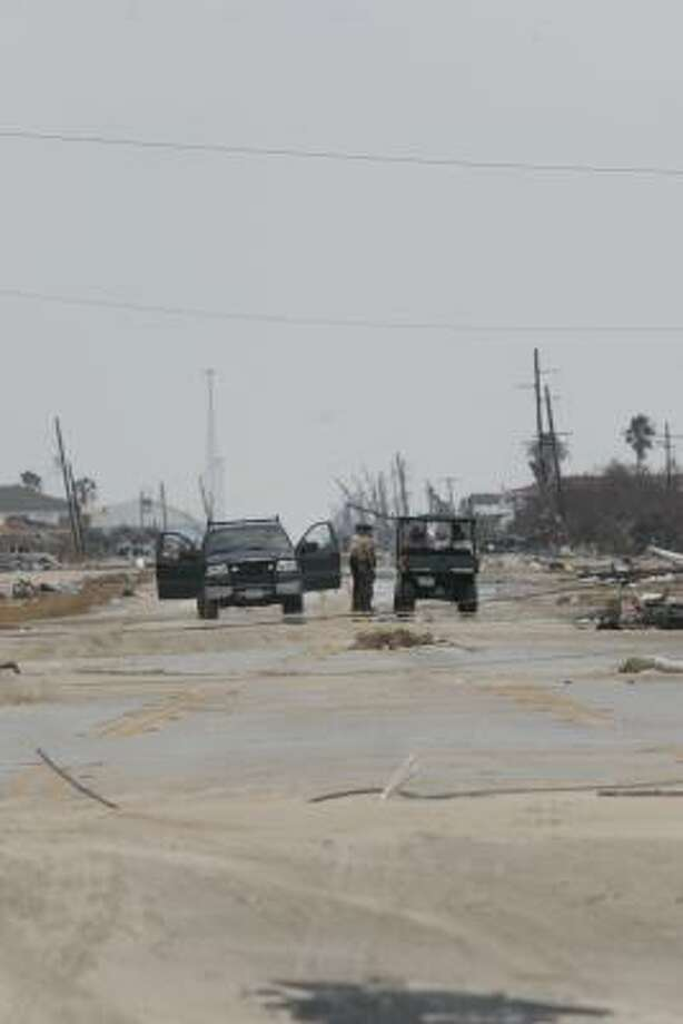 Part of the Texas Parks and Wildlife Department game warden team conducting search and rescue efforts on Bolivar Peninsula. Bolivar Peninsula after Hurricane Ike, September 16, 2008. Photo: Shannon Tompkins, HOUSTON CHRONICLE