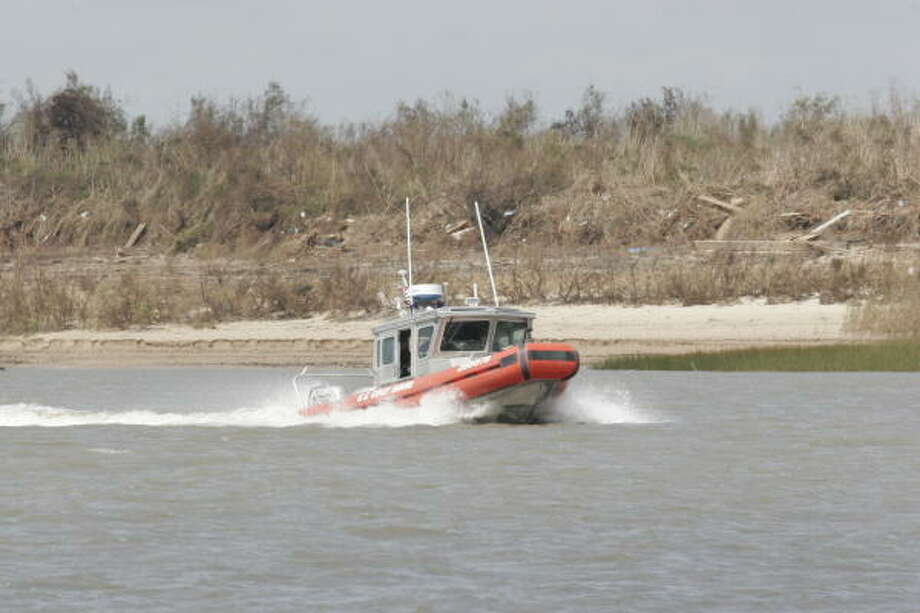 A Coast Guard patrol boat in the Intracoastal Waterway along Bolivar Peninsula. Bolivar Peninsula after Hurricane Ike, September 16, 2008. Photo: Shannon Tompkins, HOUSTON CHRONICLE