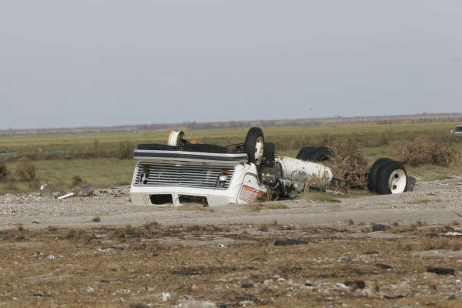Some of the scores of vehicles destroyed on Bolivar Peninsula. Bolivar Peninsula after Hurricane Ike, September 16, 2008. Photo: Shannon Tompkins, HOUSTON CHRONICLE