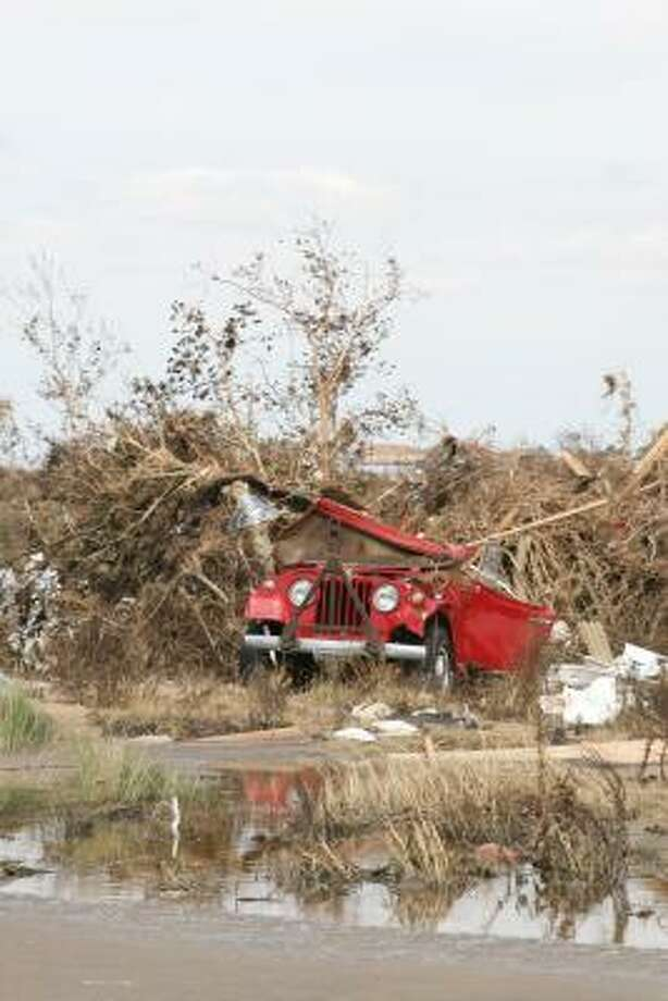 One of the scores of vehicles destroyed by wind and water when Hurricane Ike slammed into Bolivar Peninsula. Photo: Shannon Tompkins, HOUSTON CHRONICLE