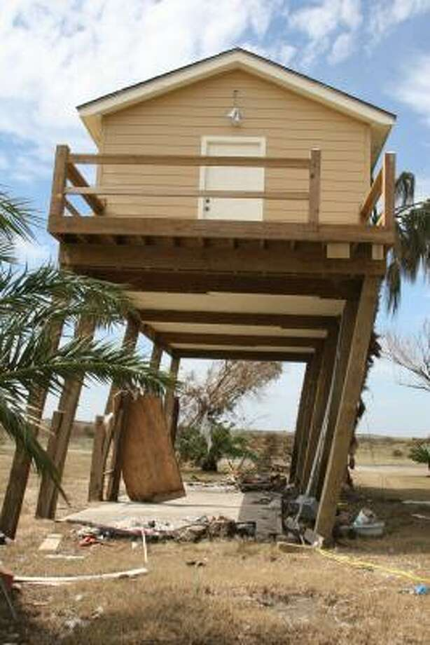 This home, one of the few remaining structures in Gilchrist on Bolivar Peninsula, leans precariously, its supporting piers cracked by Hurricane Ike's wind. Photo: Shannon Tompkins, HOUSTON CHRONICLE