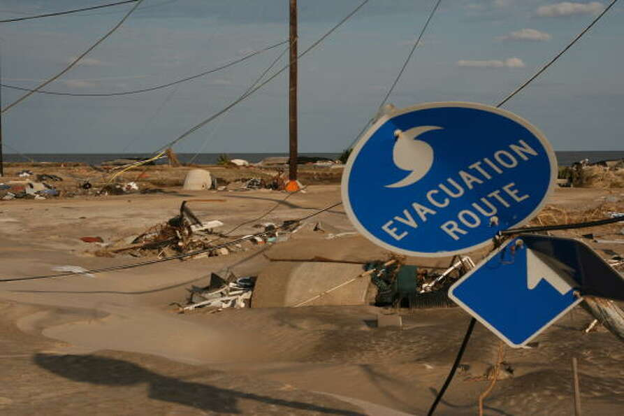 A storm-twisted hurricane evacuation sign along Highway 87 on the Bolivar Peninsula.