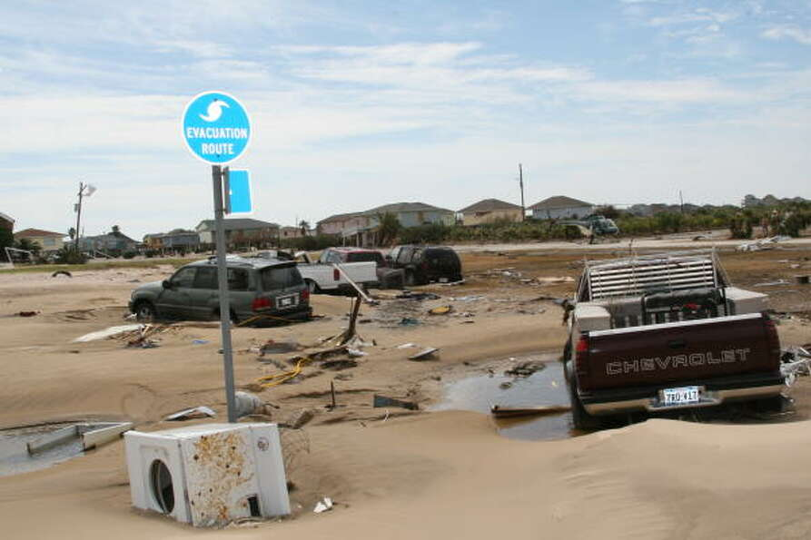 Some of the hundreds of vehicles abandoned by owners when waters rose on Bolivar Peninsula ahead of