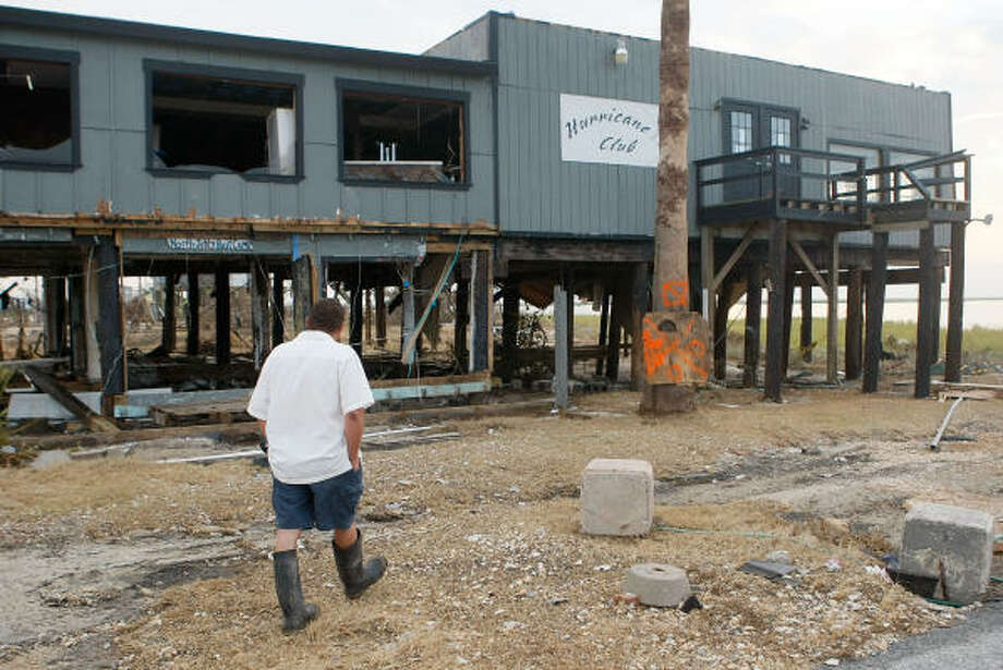 Resident Mike Ryan walks past the Hurricane Club II Sept. 18, 2008 in Bolivar. Ryan rode out the Hurricane in the nearby old bunker of Ft. Travis along with eleven others and one dog. Photo: Mark Wilson, Getty Images